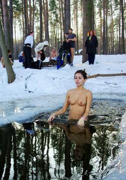 Nudist girl swimming in river in the..