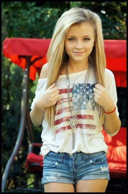 Cute young girl with long hair blonde..